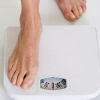 Eating Disorders - stepping onto scales